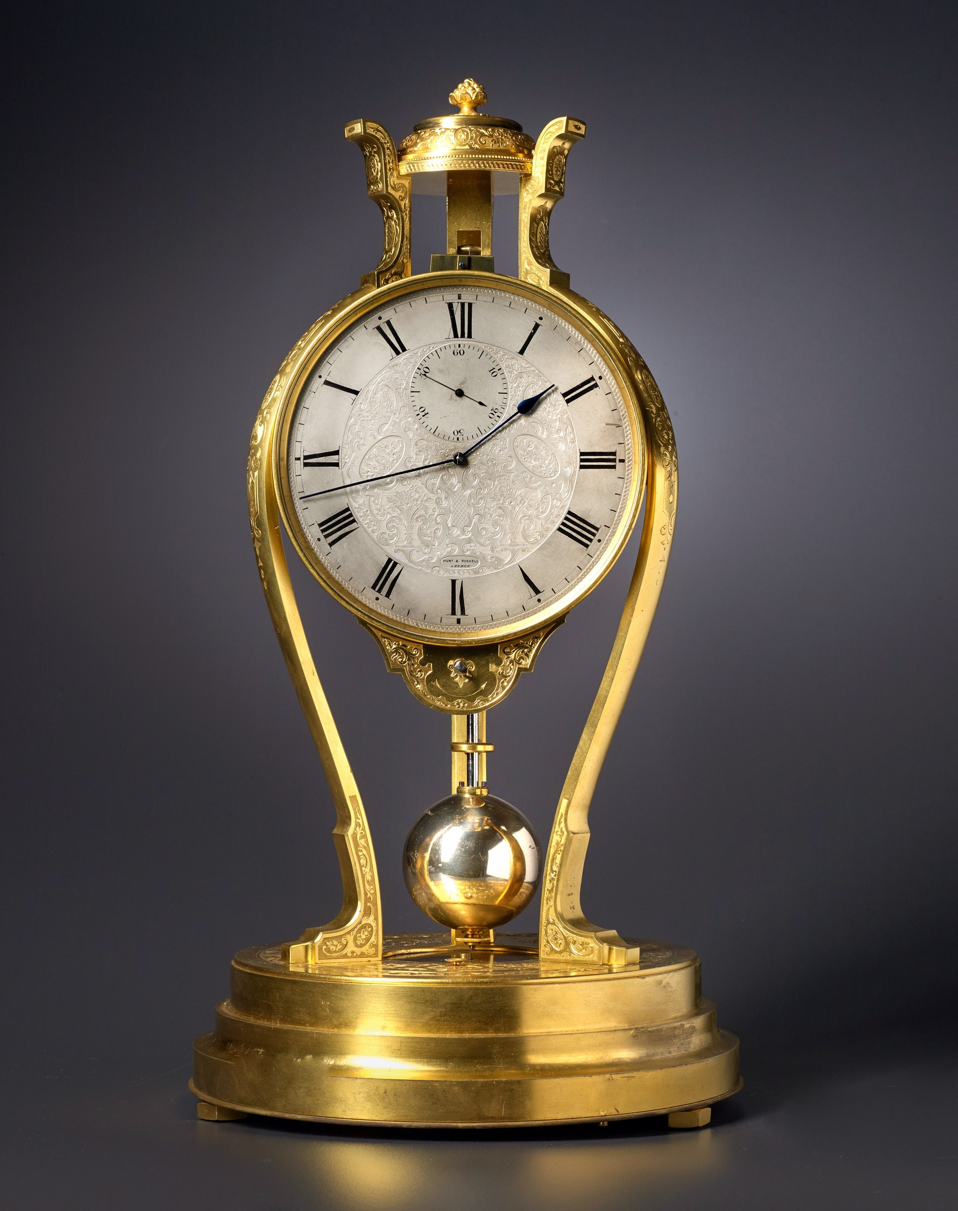 Thomas Cole A Victorian tripod clock of one month duration made by