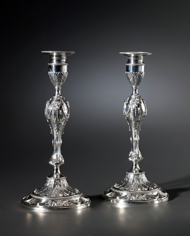 A pair of English candlesticks by Georges Cowles, London, 1777
