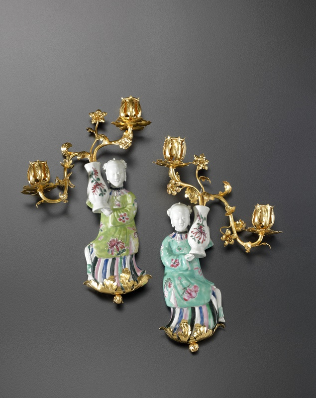 A pair of Louis XV two-light wall-lights, The porcelain figurines: China, probably Jingdezhen, Qing Dynasty, late Kangxi period (1662-1722). The gilt bronzes: Paris, date circa 1750