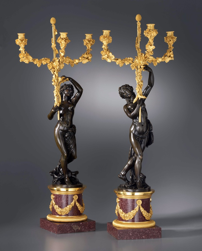 A pair of Louis XVI three-light figural candelabra after a model attributed to Clodion, Paris, date circa 1780-85