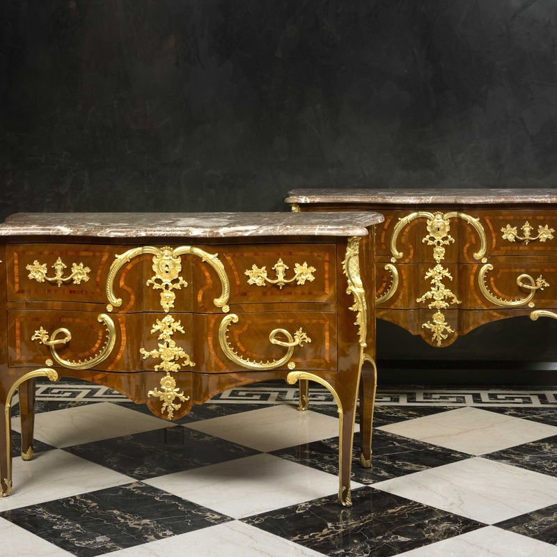 Charles Cressent (after) - A pair of late eighteenth early nineteenth century Rococo style commodes after Charles Cressent