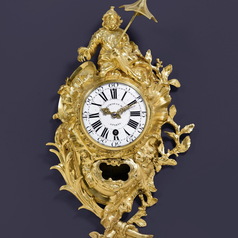 Delorme Le Jeune - A Louis XV cartel clock of eight day duration by Delorme Le Jeune