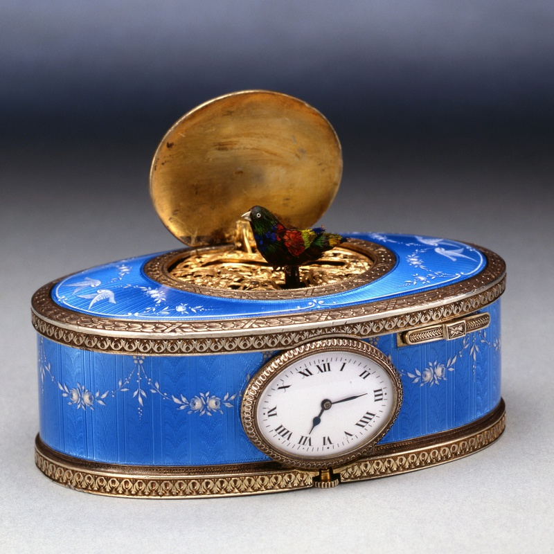 Paul Leopold Buhré - An oval singing bird box with clock, by Paul Leopold Buhré