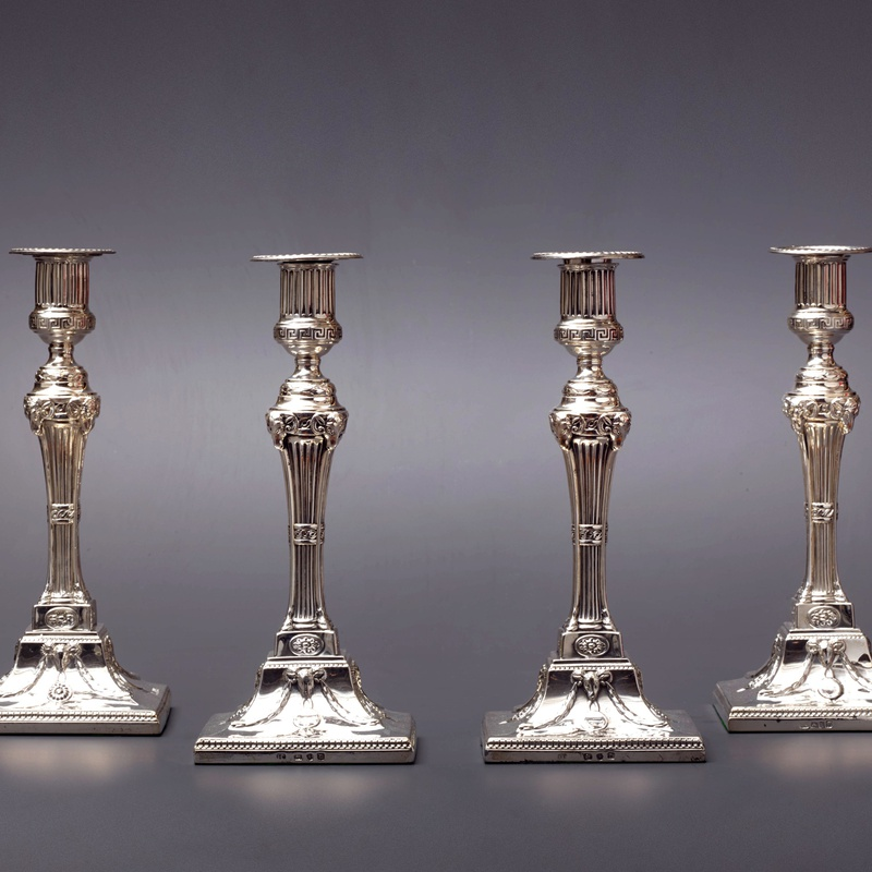 John Carter - A set of four 18th Century candlesticks
