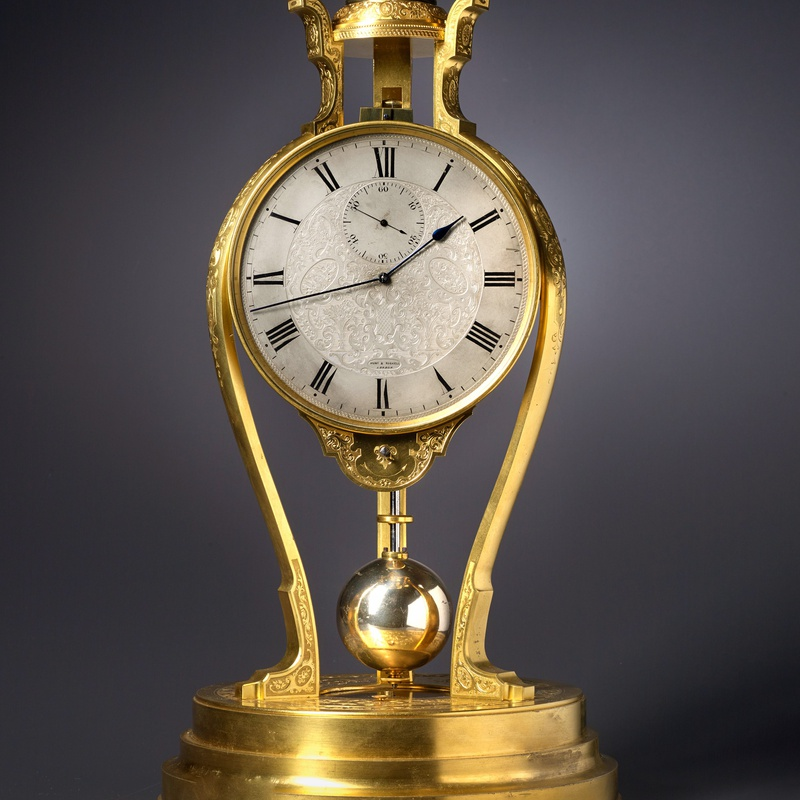 Thomas Cole - A Victorian tripod clock of one month duration made by Thomas Cole and retailed by Hunt and Roskell of London