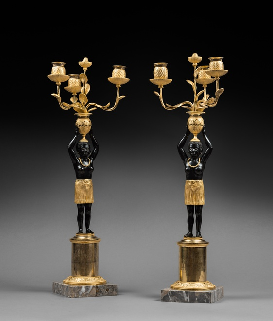 A pair of Directoire three-light candelabra 'Au Jeune Nègre', attributed to Jean-Simon Deverberie