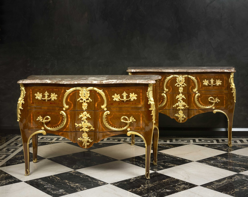 A pair of late eighteenth early nineteenth century Rococo style  commodes after Charles Cressent